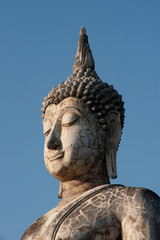 Face of outdoor ancient big Buddha in Sukhothai temple, Thailand
