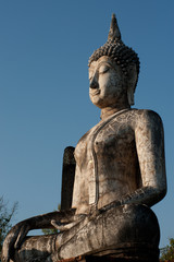 Outdoor ancient big Buddha in Sukhothai temple, Thailand .