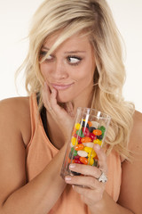 woman with glass of jelly beans
