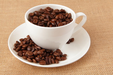 Coffee Bean and cup with linen background