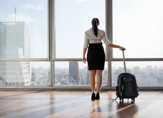 Businesswoman With Luggage Trolley