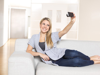 young woman taking picture of herself