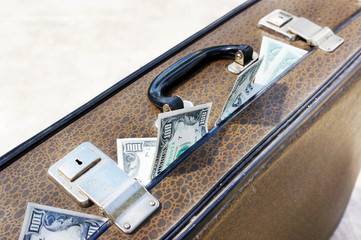 Old suitcase full of money