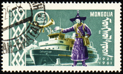 Passenger ship and man in Mongolian costume on post stamp