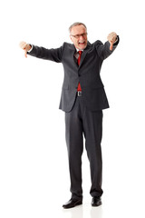 angry senior business man with thumbs down