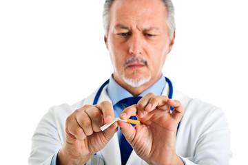 Doctor breaking apart a cigarette