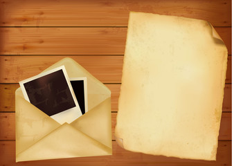 Old envelope and paper on wooden background.