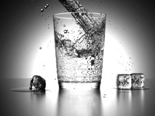 Water Splash into a glass with icecubes beside the glass