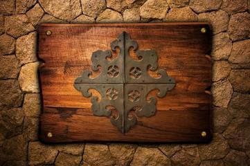 vintage wood board on stone wall