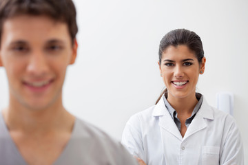 Confident female doctor smiling