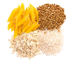 Macaroni, rice, buckwheat and oatmeal isolated on white