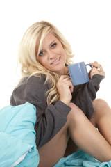 woman bed mug looking