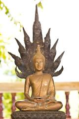 buddha statue with head of naga