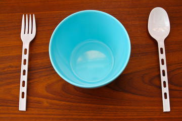 Blue bowl with plastic spoon and fork