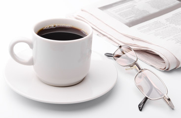 Eyeglass and newspaper