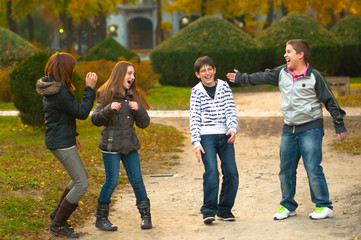 Teenage boys and girls having fun in the park