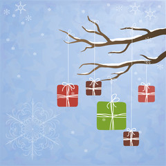 Winter background with gifts hanging on a tree