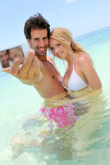 Couple taking picture of themselves in the sea