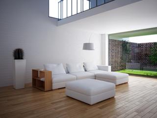 Interno con divano e vista su giardino