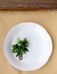 plates with  sprig of parsley - organic menu