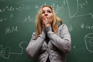 frightened girl near green school board