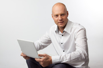 Portrait of middle-aged man with a white laptop computer