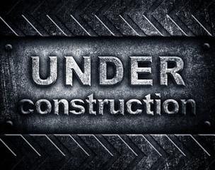 """""""under construction"""" word on metal plate"""