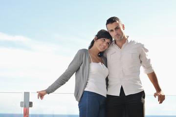 couple relaxing on balcony