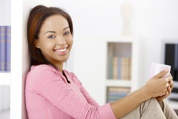 Happy woman with coffee mug