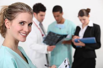 A team of doctors conferring