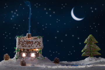 Gingerbread home with blue smoke and moon with stars