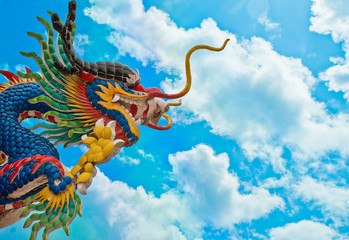Dragon on blue sky