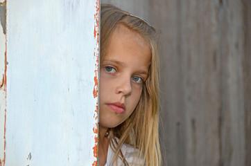 girl peeking around door
