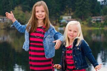 cute kids outside at a lake