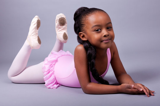 Cute little African American girl wearing a ballet costume