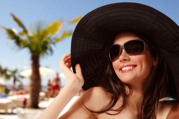 summer beach teen girl cheerful in panama and sunglasses