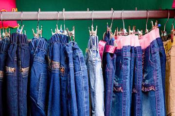 Denim pants on a hanger for children in the store