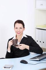 Beautiful business woman during coffee break..