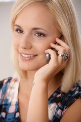 Beautiful blonde with cellphone
