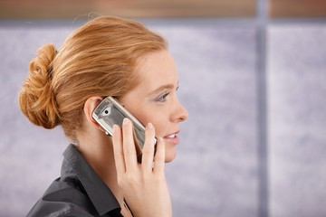 Side view portrait of redhead on phone
