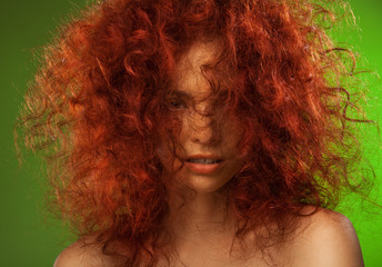 Red curly hair woman beauty portrait