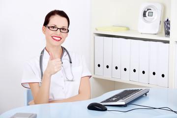 Attractive doctor showing okay gesture.