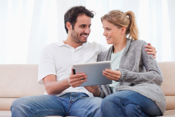 Young couple using a tablet computer