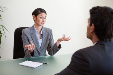 Manager interviewing an employee