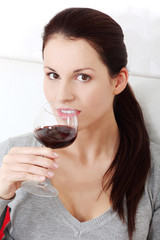 Smiling woman holding a glass of wine.