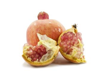 Fototapete - juicy pomegranate on white background