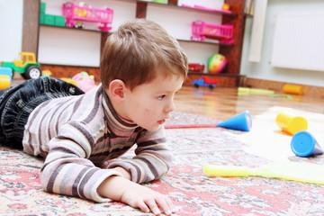 Little Boy Playing in Nursery