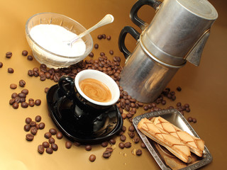an espresso cup moka napoletana and cookies