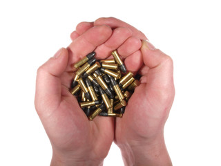 Handful of bullets isolated on white.
