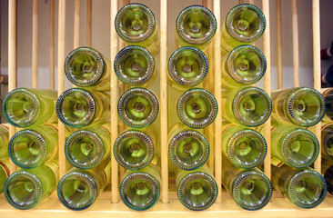 Fototapete - White wine bottles in rack